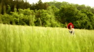 Beautiful Young Red hair Woman having Fun in the Meadow video
