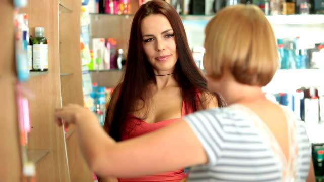 Beautiful Young Woman Buying Cosmetics video
