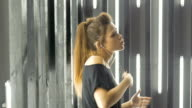 Beautiful young woman dancing in a nightclub, listening to music through headphones. Slow motion. video