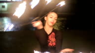 beautiful young woman dancing with fire video