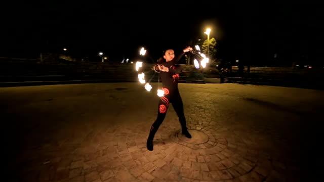 beautiful young woman dancing with fire,camera stabilization shoot video