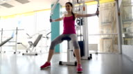 beautiful young woman doing a beautiful figure in the gym video