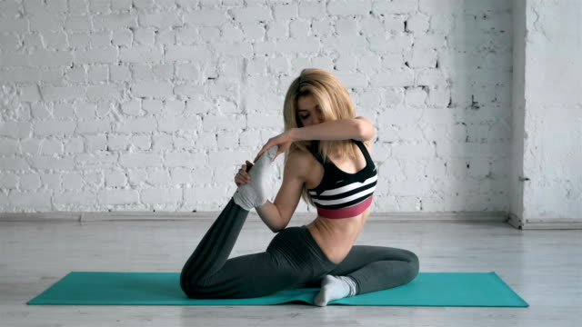 Beautiful Young Woman Doing Yoga Exercise One-Legged King Pigeon Pose, Side View video