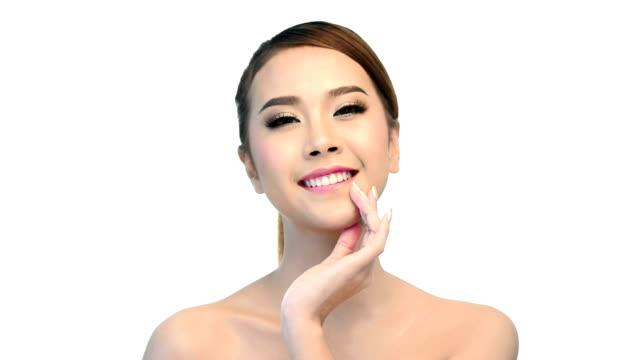 Beautiful young woman face close up video