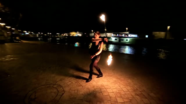 beautiful young woman have performance with fire,camera stabilization shoot video