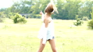 Beautiful young woman having fun in nature,slow motion video