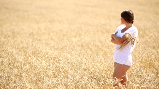 beautiful young woman in a wheat field video