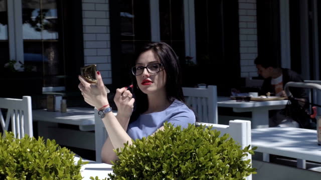 Beautiful Young Woman In An Outdoor Cafå video