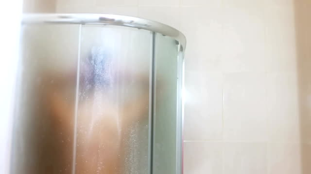 Beautiful Young Woman is Showering in the Shower Cabin video