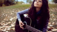 Beautiful young woman play guitar video