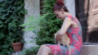beautiful young woman playing and stroking ( pet ) a cat video