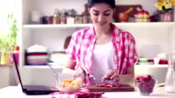Beautiful Young Woman Preparing Healthy Breakfast video