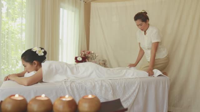 Beautiful young woman receiving legs massage video