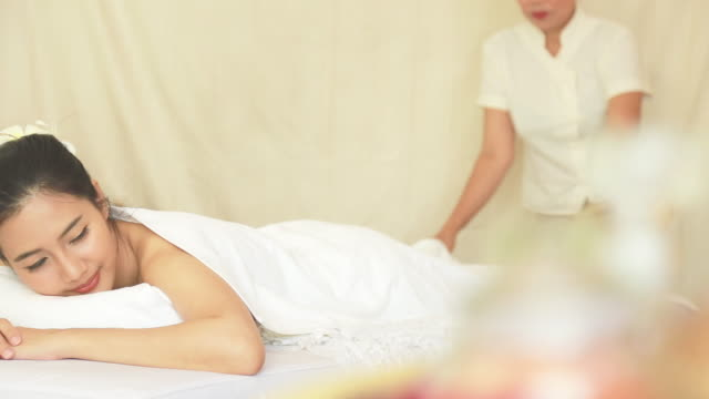 Beautiful young woman receiving massage and spa video