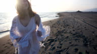 beautiful young woman running on the beach video