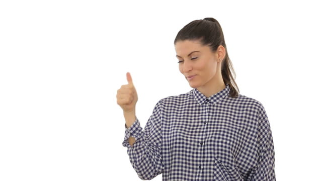 Beautiful young woman showing thumbs-up, isolated on white background. video