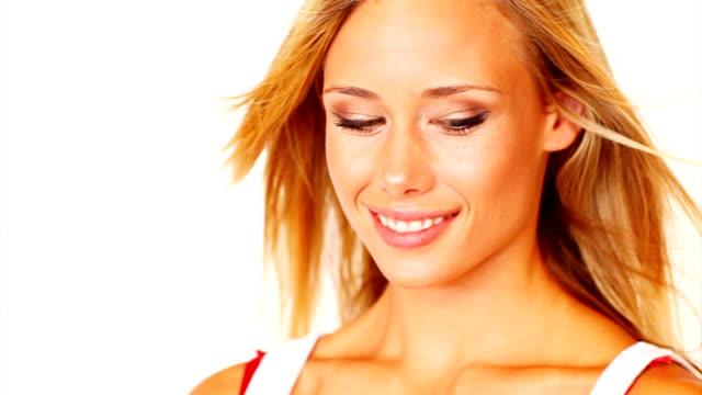 Beautiful young woman smiling flirtatiously video