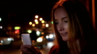 Beautiful young woman, urban smartphone. video