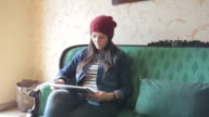 Beautiful young woman using the tablet. video
