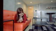 beautiful young woman wandering on a sofa using a digital tablet video