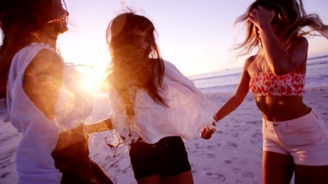 Beautiful young women dancing on the beach video