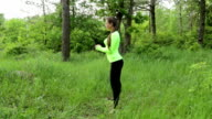 beautiful young women doing squats exercising in the nature video