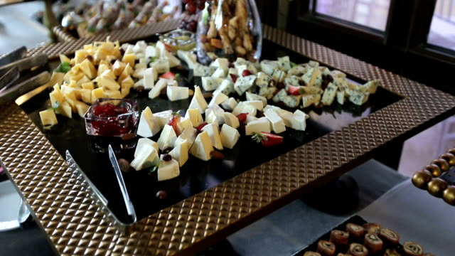 Beautifully decorated catering banquet table with different food snacks and appetizers video