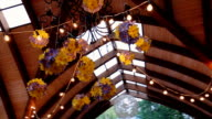 Beautifully decorated Colorful flowers specified hall for carrying out a wedding holiday party at a fixed wooden shed, outdoor pavilion for outdoor events video