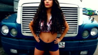 Beauty Girl stand at front of truck on sunset video