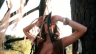 Beauty portrait of a boho girl in afternoon sunlight video