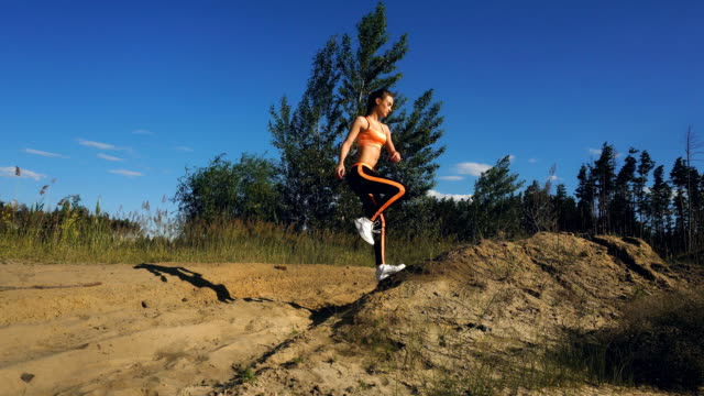 beauty sports woman makes exercices outdoors video
