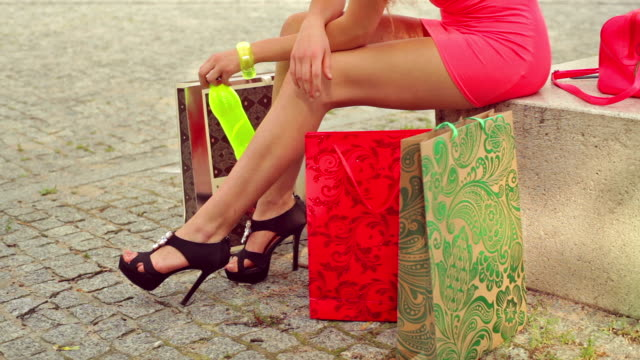 Beauty woman legs and shopping bags video
