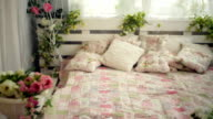bed in the bedroom with flowers rustic style video