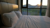 Bed room at sunset video