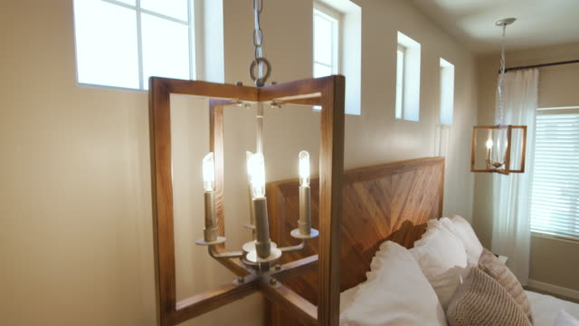 Bedroom Lowering Close Up Light to Nightstand and Bed Corner video