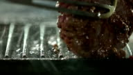 Beef burger cooking on a griddle. Slow Motion. video