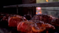 Beef meat on the grill barbecue - Panning shot video