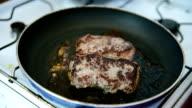 Beef ribeye steak being fried video