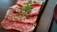 Beef sliced meat for Japanese shabu hot pot Asian style. video