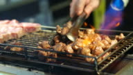 Beef steak dice cooking and flamed on bbq grill oven. Street food vendor in Taiwan video
