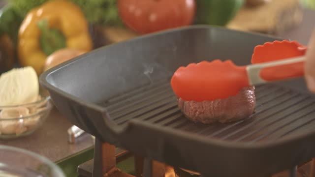 Beef steak grilling on frying pan video