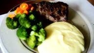Beef steak, mashed potatoes, carrots and broccoli video