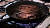 Beef steak quickly fried in oil in a frying pan video