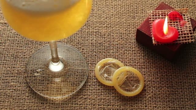 Beer candle and condom video