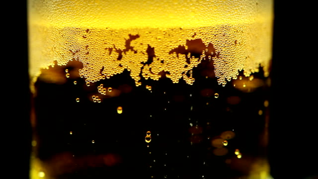 Beer is pouring into the glass. Bubbles video