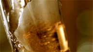 Beer is pouring into the glass. Closeup. video