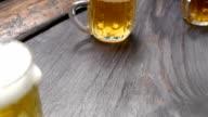 Beer mugs on black bar counter video