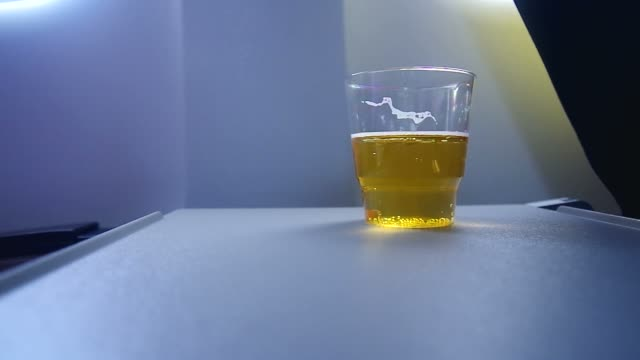 beer on the airplane desk video