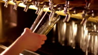 Beer pouring from tap video