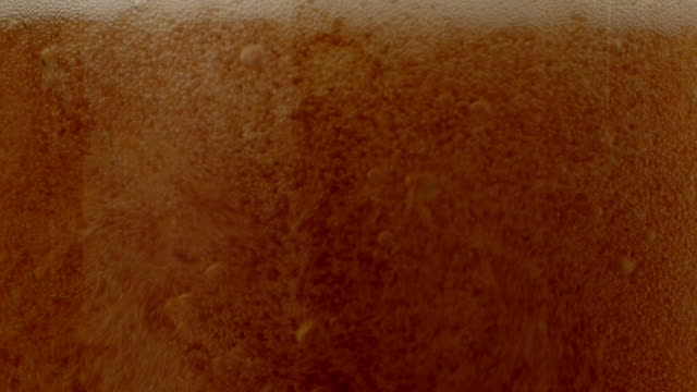 Beer pouring, slow motion video
